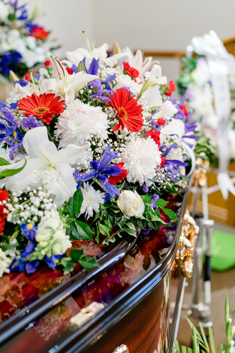 A Casket Spray of Colourful Flowers on Khim's Coffin at the Funeral Ceremony (31 Aug 2019, 9:28 AM Saturday)