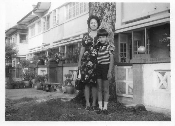 Khai & Khim standing by the tree in front of 16 Phuah Hin Leong Road (Aug 1976)