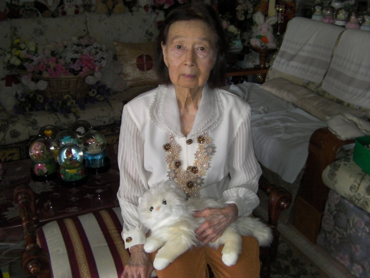 Khim on a Regency-Style Bench with a Fluffy Toy Cat (Christmas 2016, 2:22 PM Sunday)