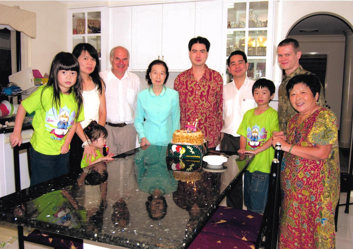 Khim on Her 75th Birthday in 2006 with two sons, one daughter-in-law, three grandchildren and three family friends.