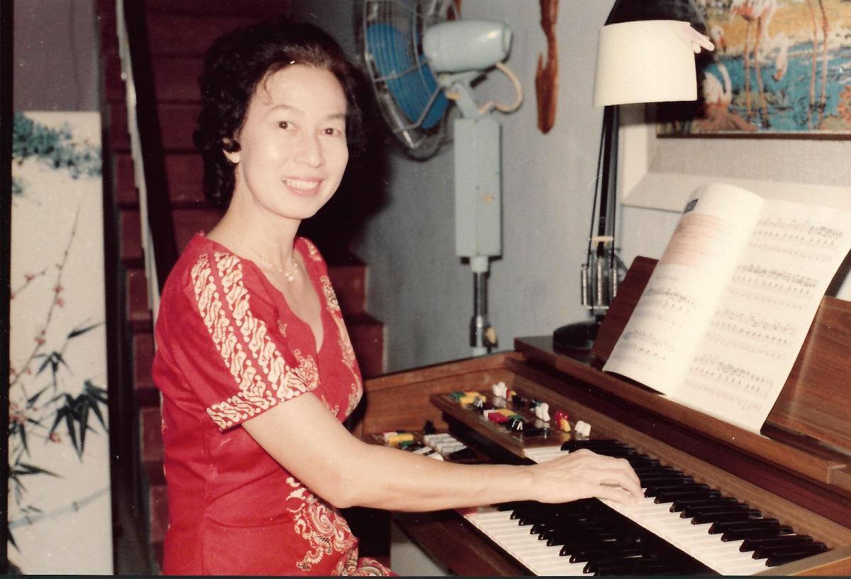 Khim Playing an Electronic Organ (Jan 1984)