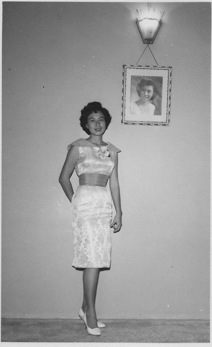 Khim standing next to her studio portrait at 16 Phuah Hin Leong Road, Penang (circa 1957 or later)